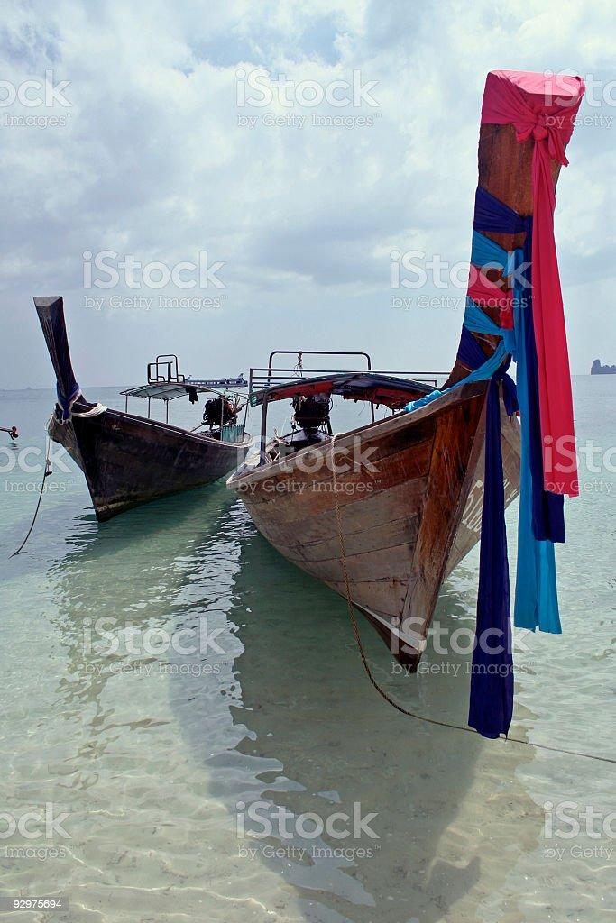 two longtail boats krabi beach thailand royalty-free stock photo