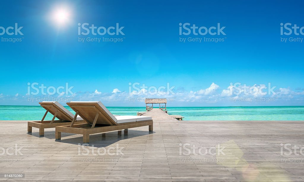 Two lounge chairs, luxury tourist resort, tropical beach, ocean view stock photo