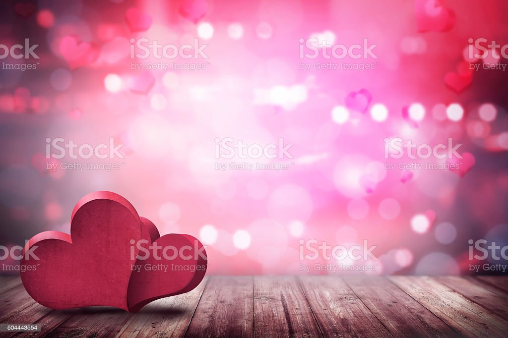 Two love shape on the wooden floor stock photo