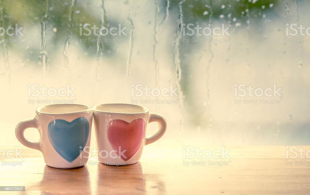 two lovely glass on rainy day window background stock photo