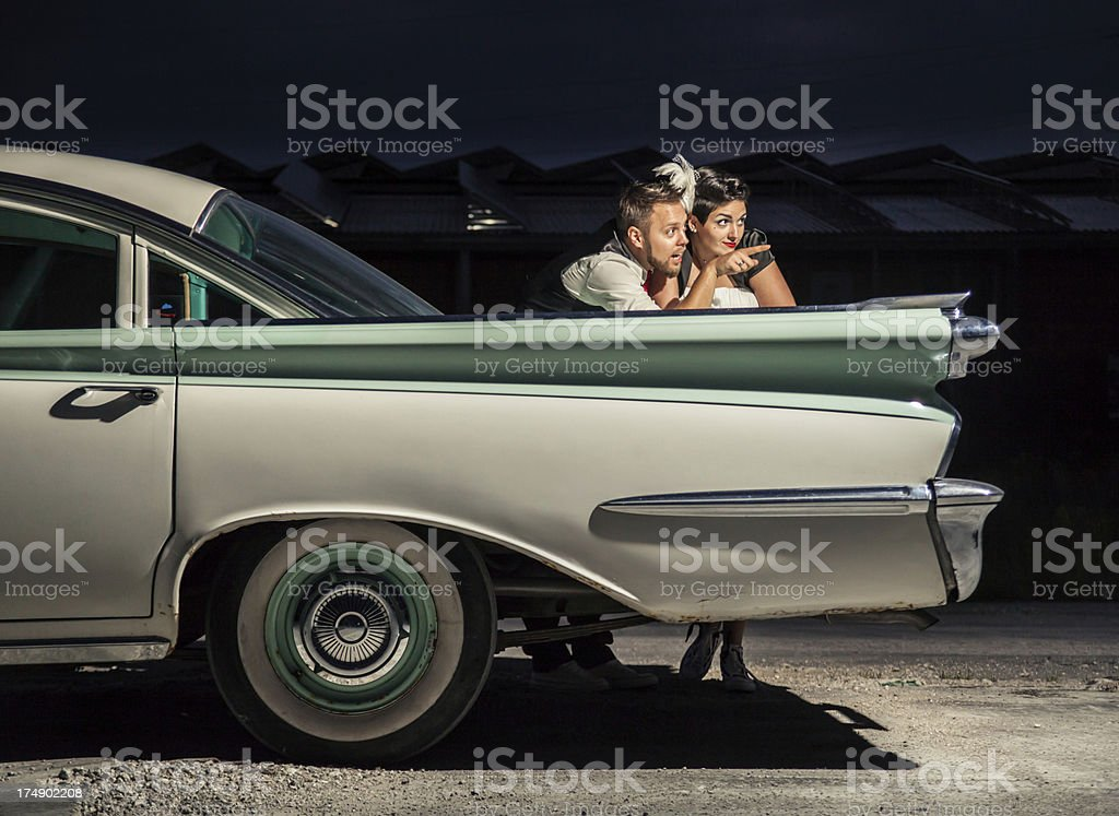 Two lovers by the car royalty-free stock photo