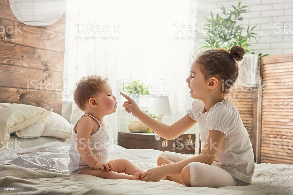 two loving sisters stock photo