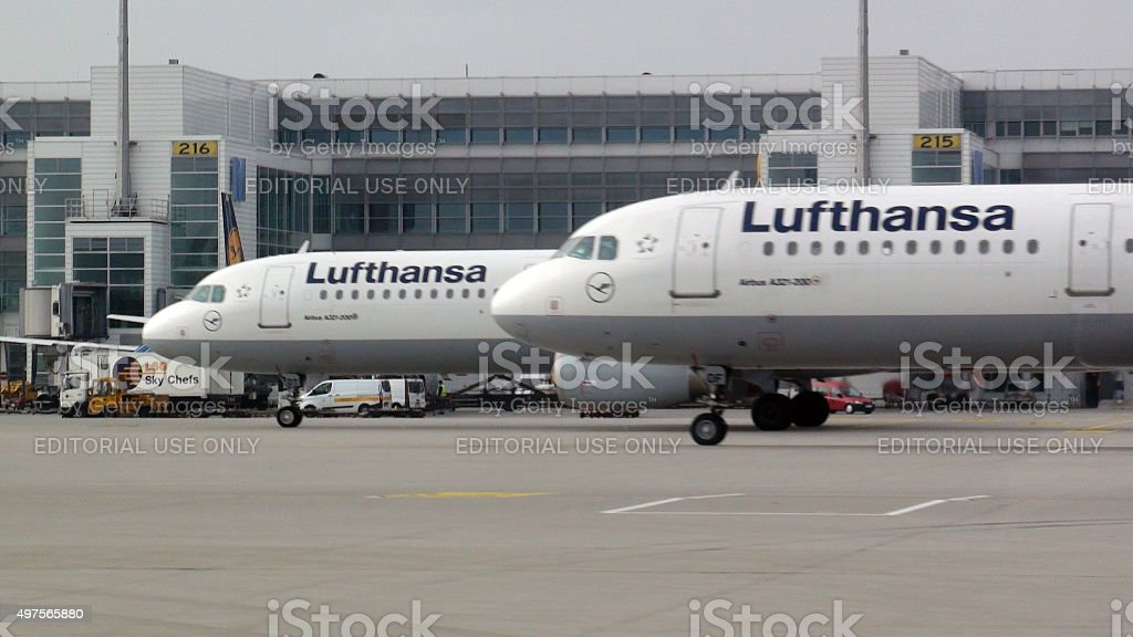 Two Lufthansa Passenger Airplane Parked At Loading Gate.Munich Airport,Germany stock photo