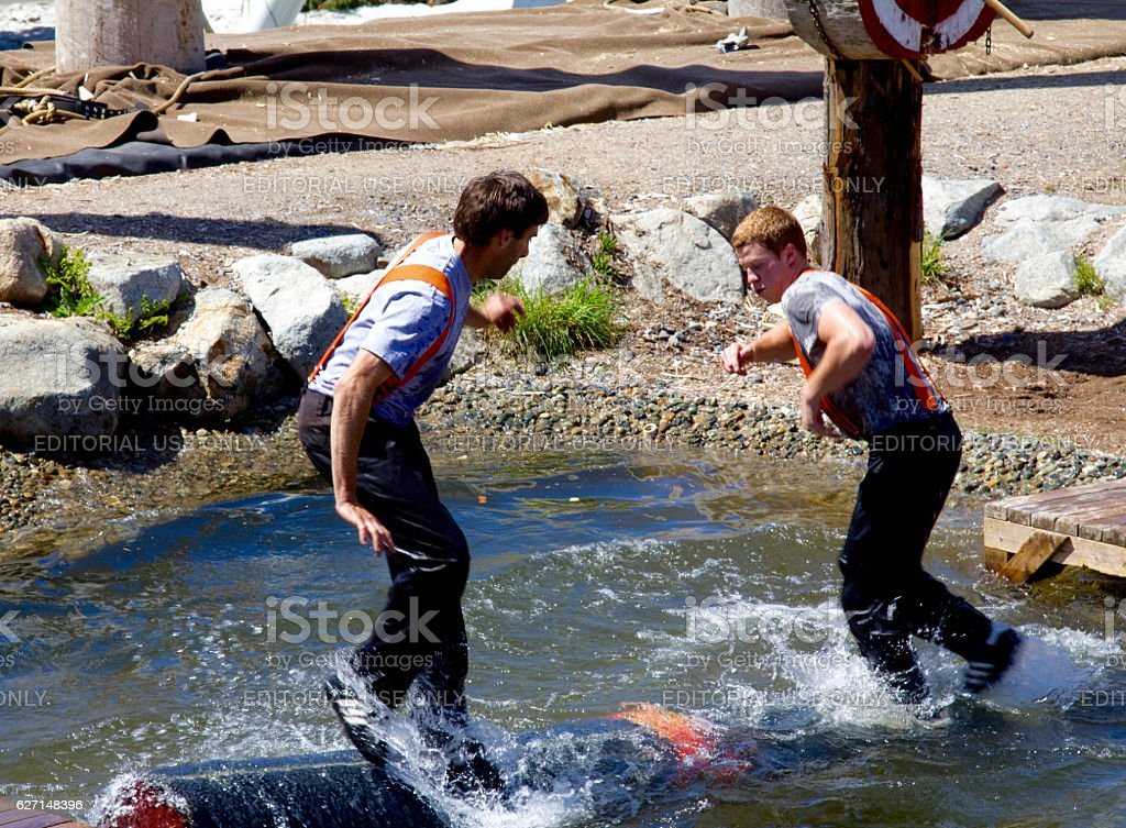Two lumberjacks participate in water log rolling on Grouse Mountain stock photo