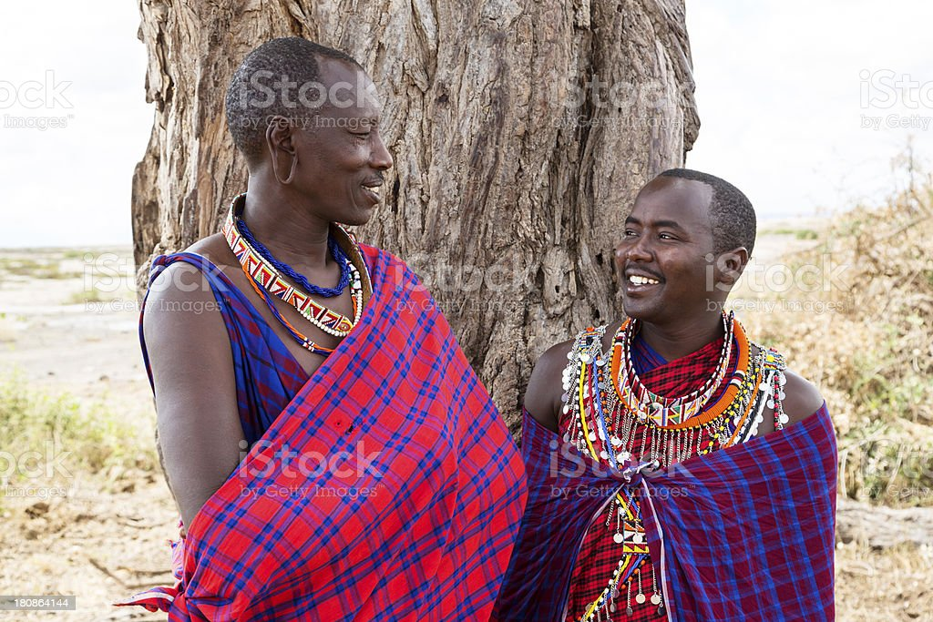 Two maasai men in traditional dress stock photo