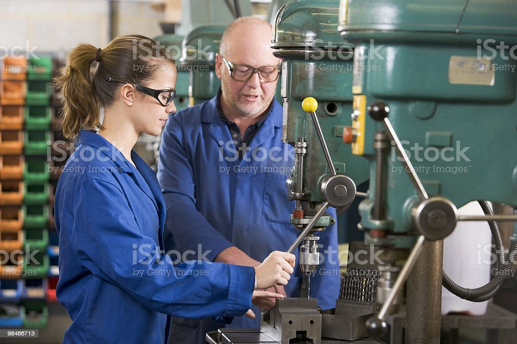 Two machinists working on machine stock photo