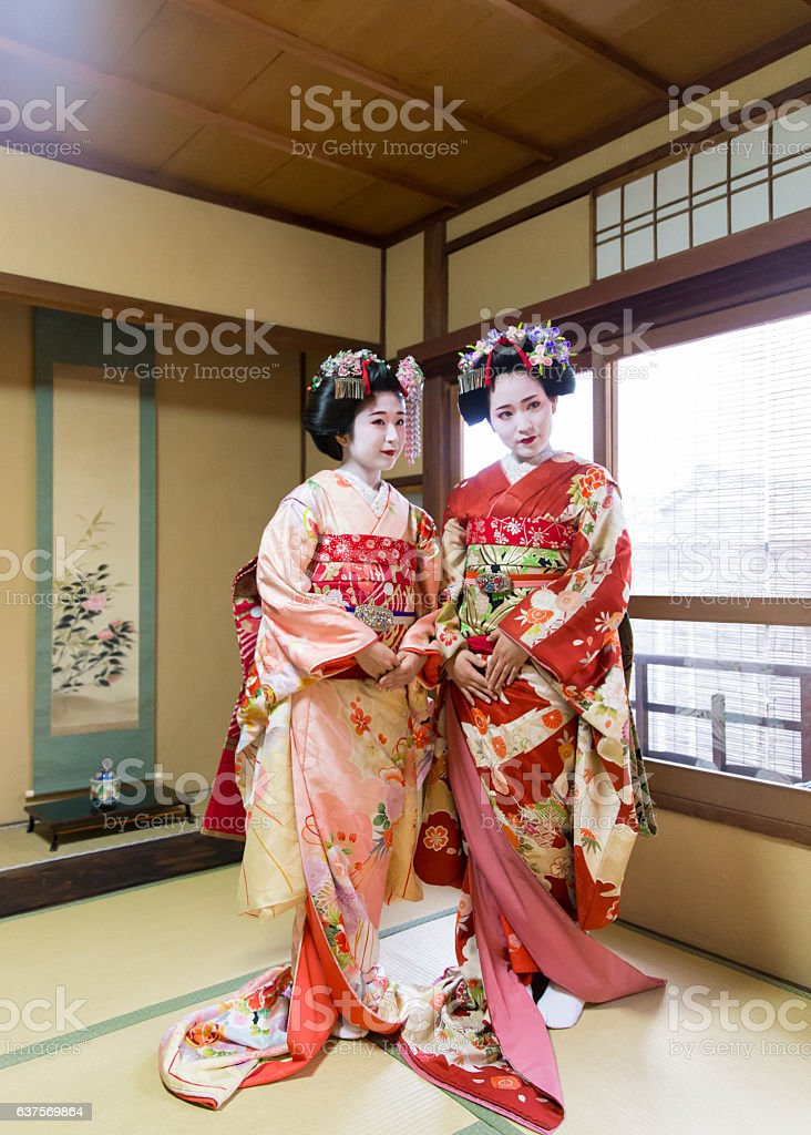 Two Maiko girls standing in Japanese tatami room stock photo