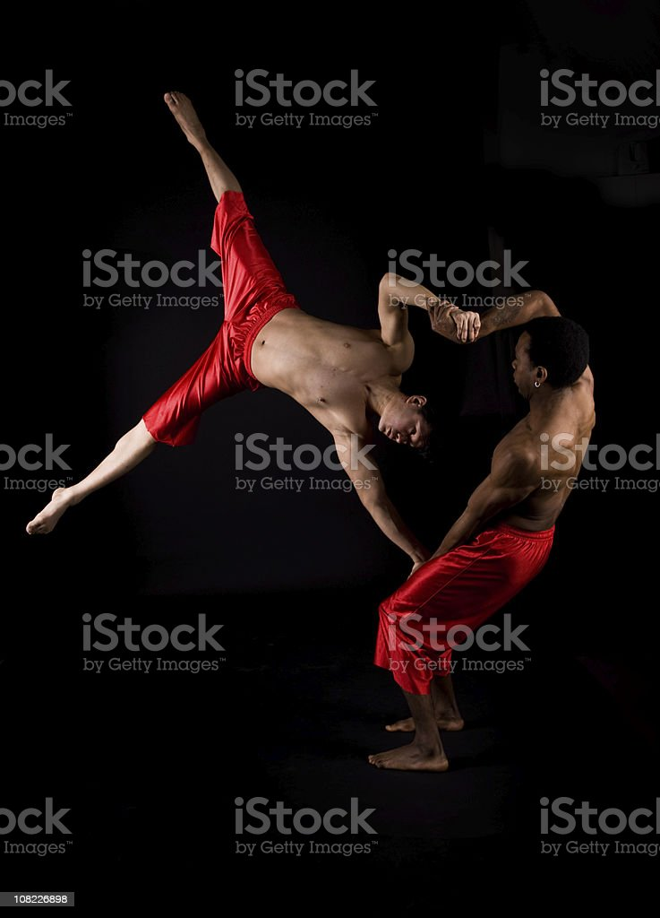 Two Male Acrobats Posing, Isolated on Black stock photo