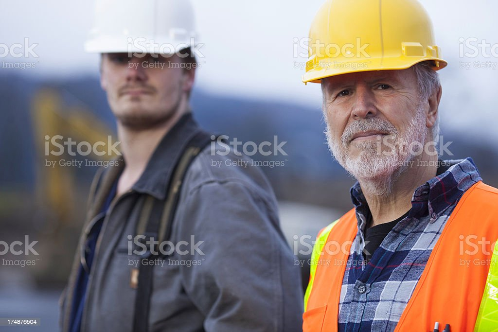 Two male construction workers on a job site. royalty-free stock photo