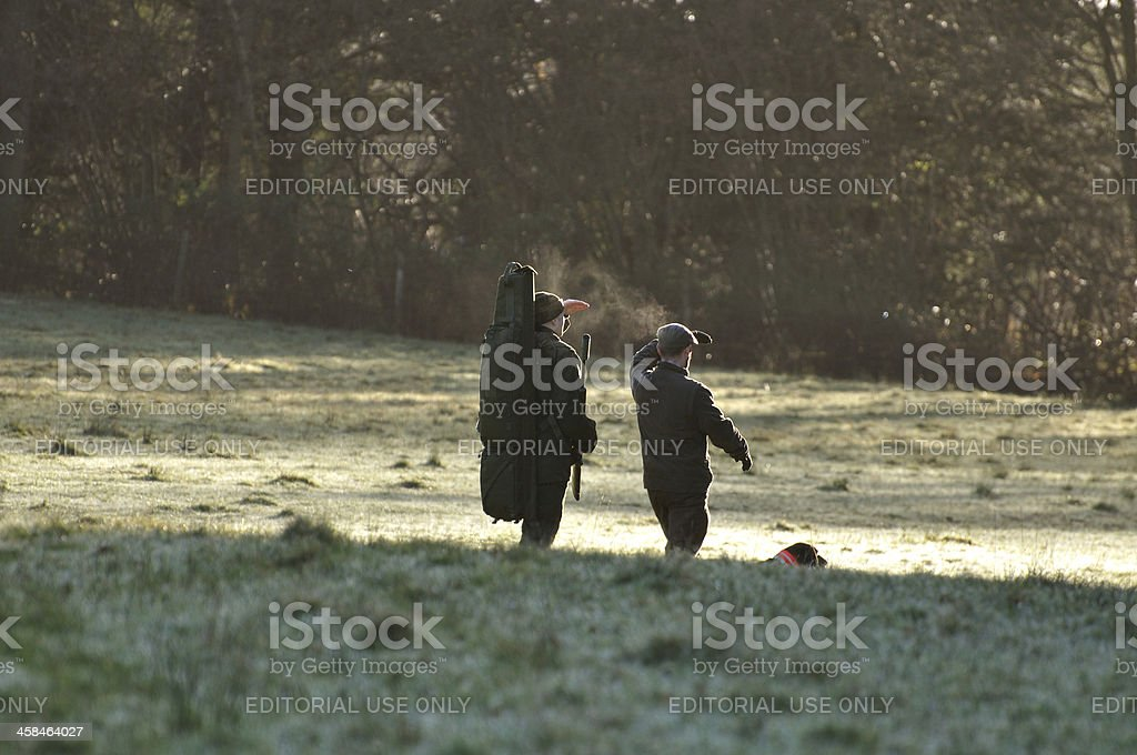 Two male deer stalkers looking royalty-free stock photo