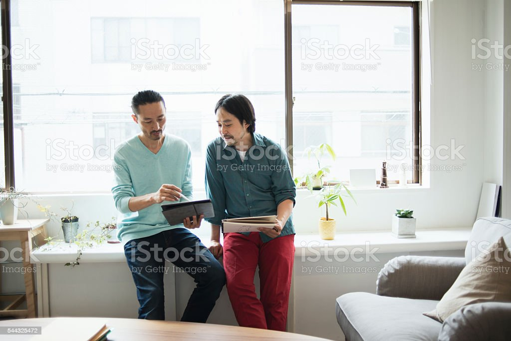 Two male designers working in studio stock photo
