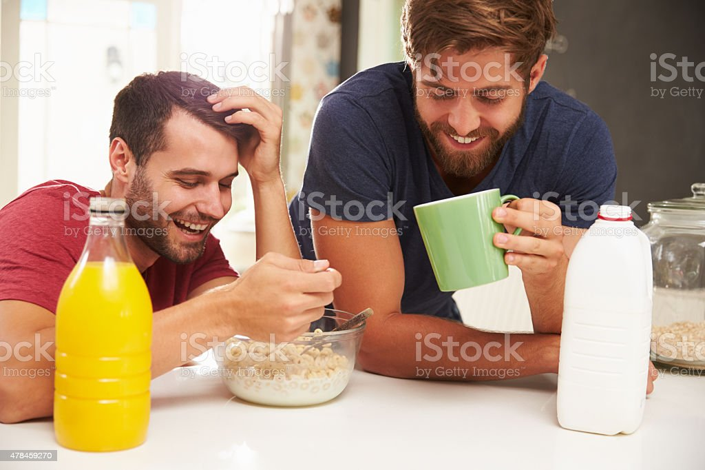Two Male Friends Enjoying Breakfast At Home Together stock photo
