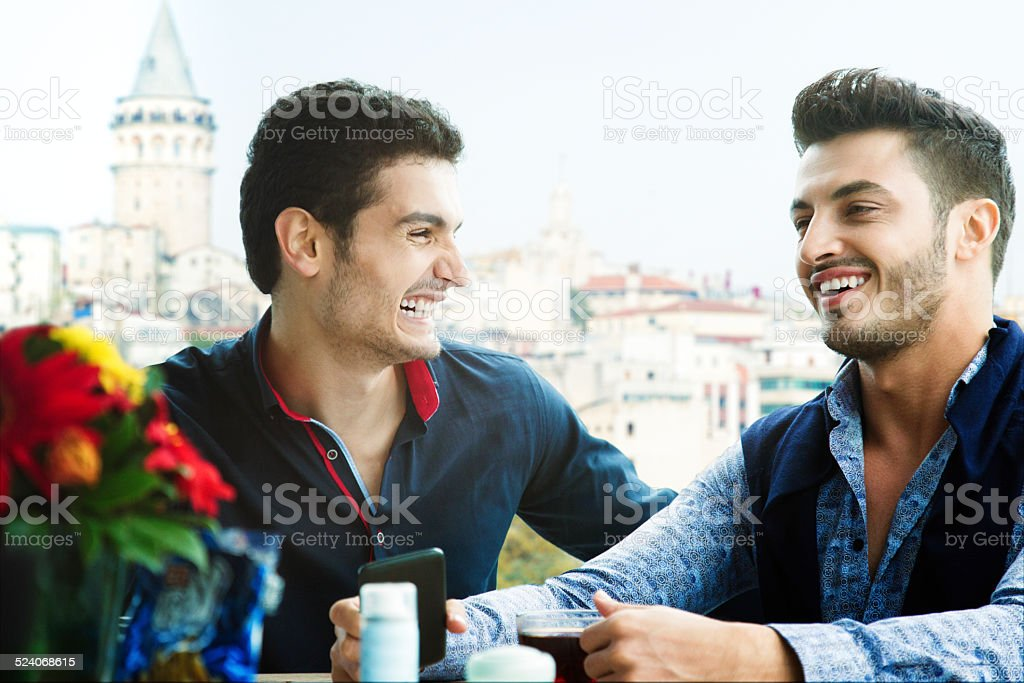 Two male friends laughing in an Istanbul cafe stock photo