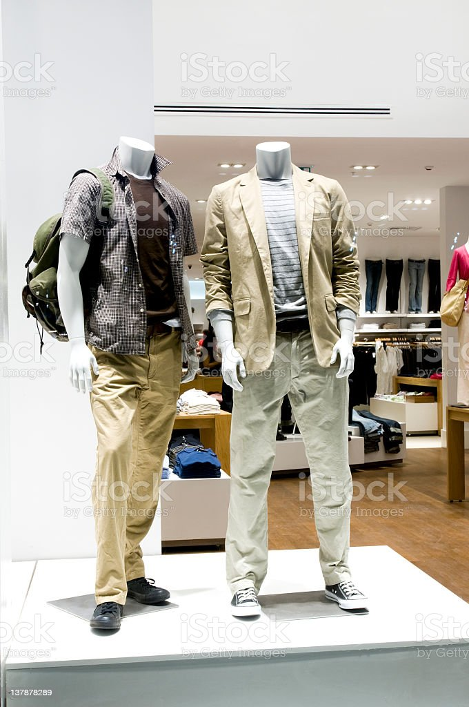 Two male mannequins in a store stock photo