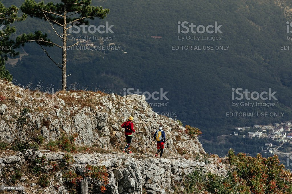 two male runners on top mountain stock photo