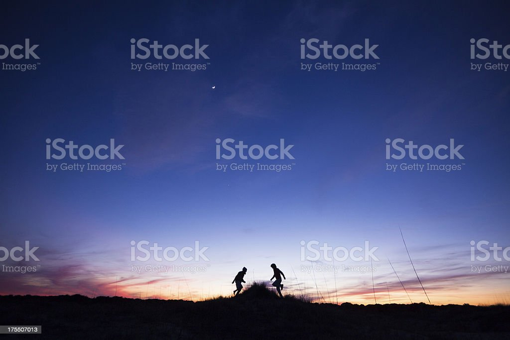 Two Male runners out for a training run at sunset stock photo