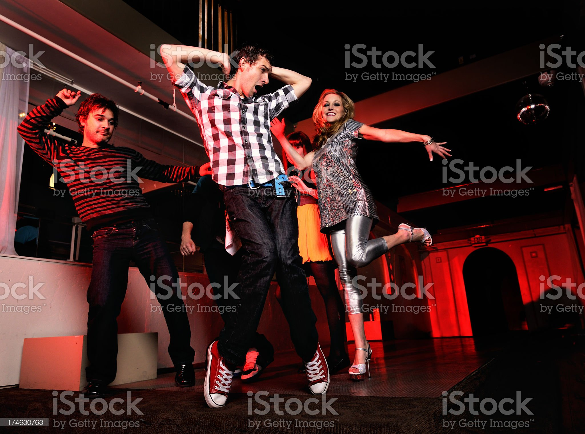 Two males and female dancing on a dance floor royalty-free stock photo