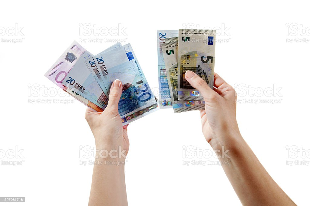 Two man arms are holding euro money bills stock photo