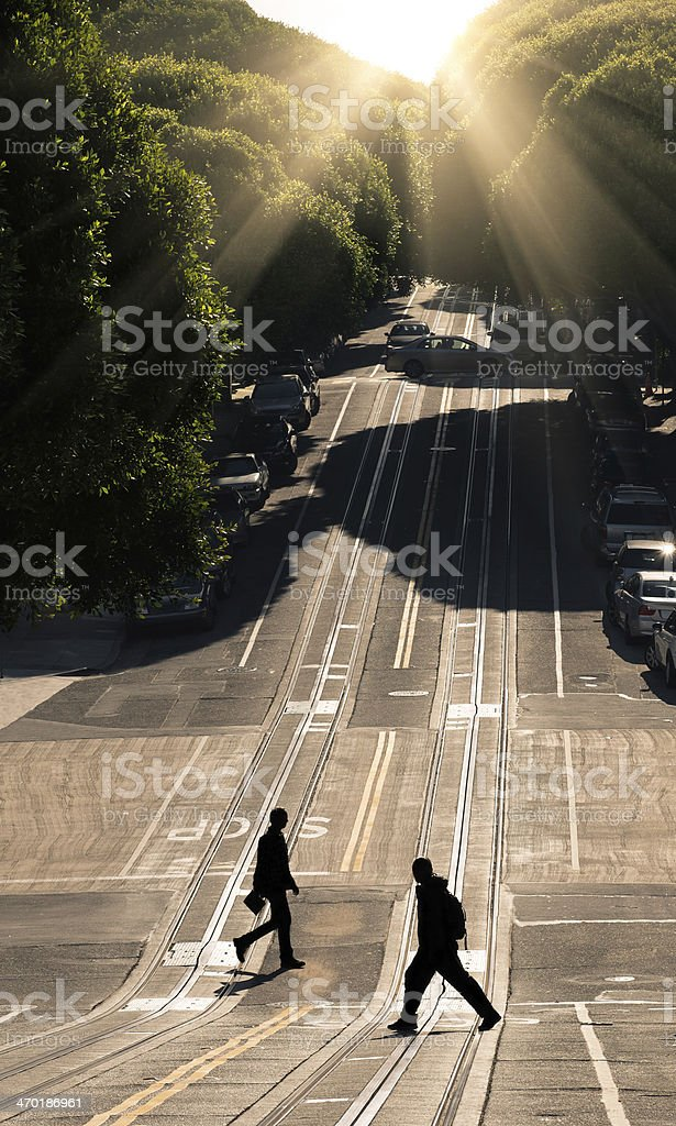 Two man crossing the road - San Francisco, Hyde Street stock photo