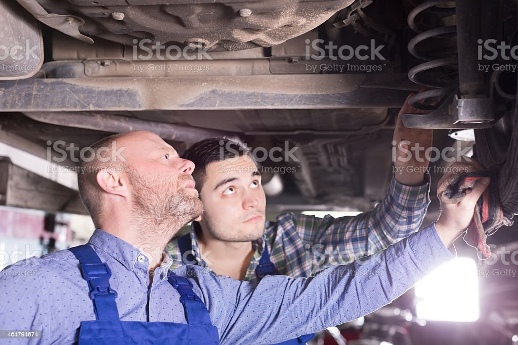Two man fixing car stock photo