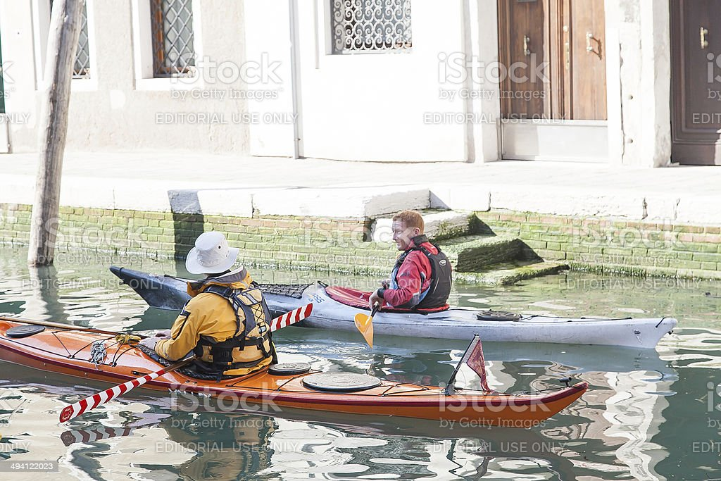 Two man on a kayak at grand canal , venice,italy stock photo