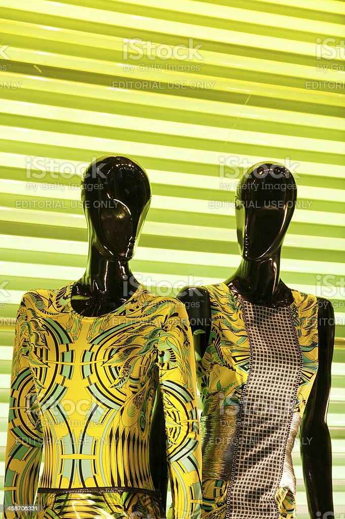 Two mannequins in Versace dresses stock photo