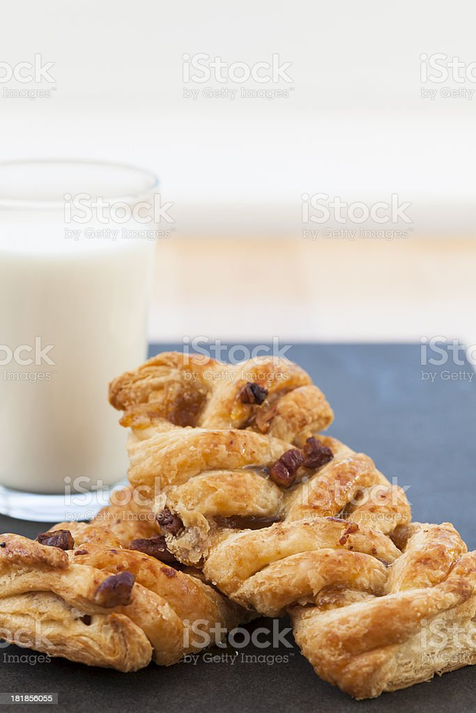 Two Maple Pecan Plaited Pastries With A Glass Of Milk royalty-free stock photo
