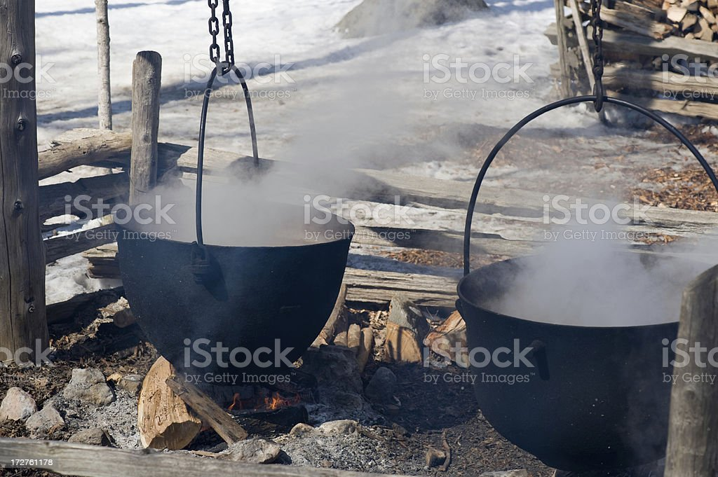 Two maple syrup making kettles stock photo