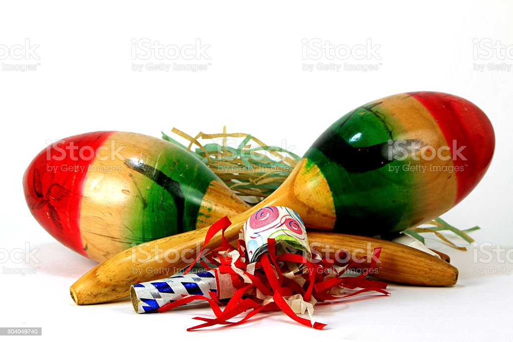 Two Maracas with party noise makers stock photo