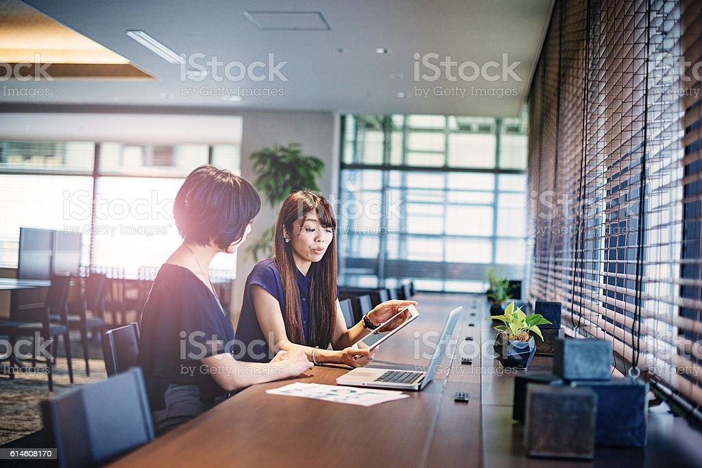 Two market specialists in Japan working together. stock photo