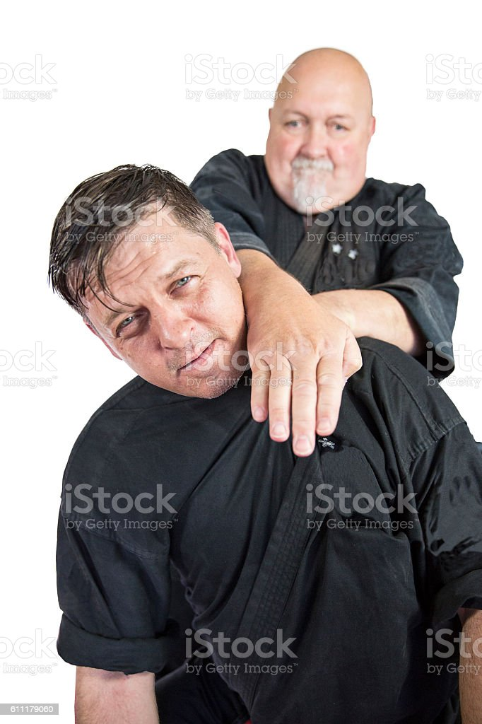 Two Martial Art experts fighting by hand stock photo