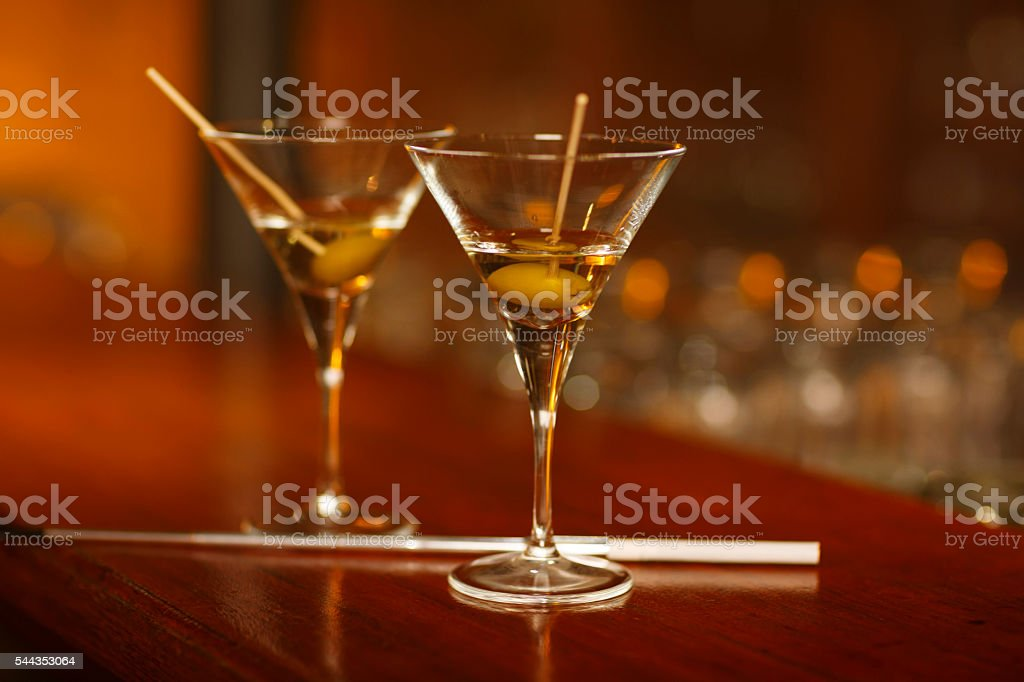 Two Martini glass  standing on wooden counter bar   Dry martini stock photo