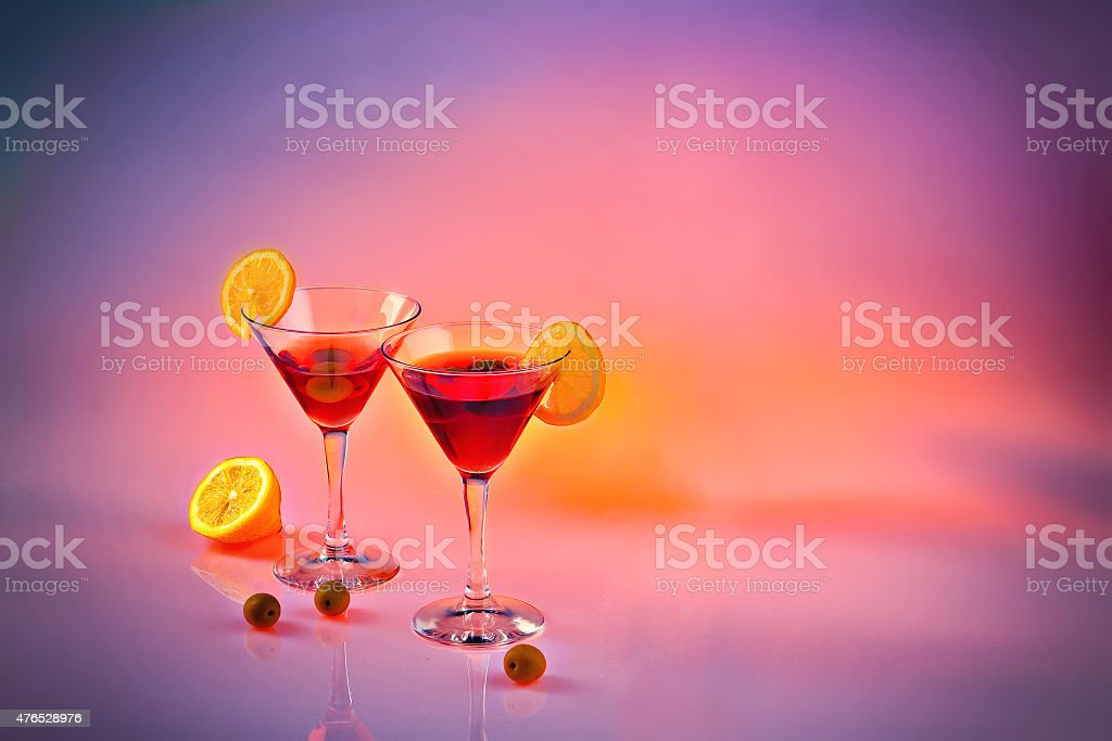 Two martinis on pink background stock photo