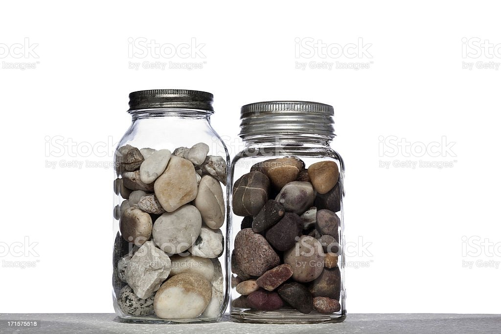 Two mason jars full of rocks stock photo