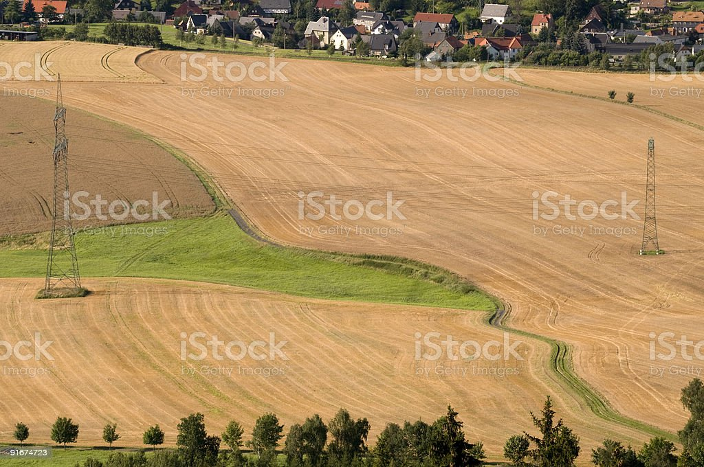 Two mast at a field with houses. stock photo