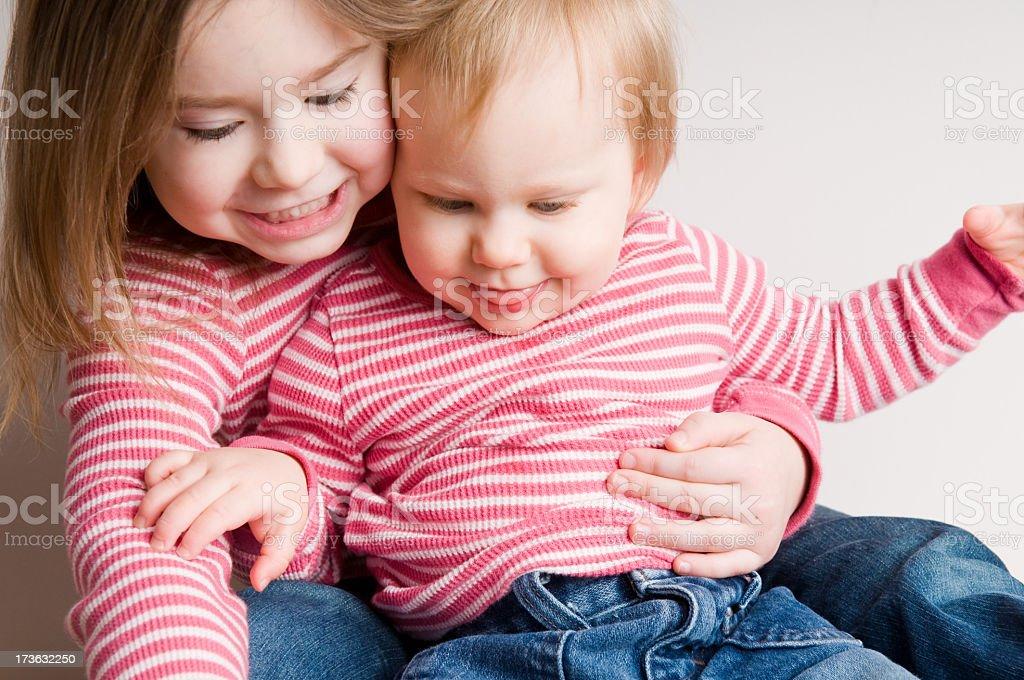 Two Matching Sisters Sitting Together royalty-free stock photo
