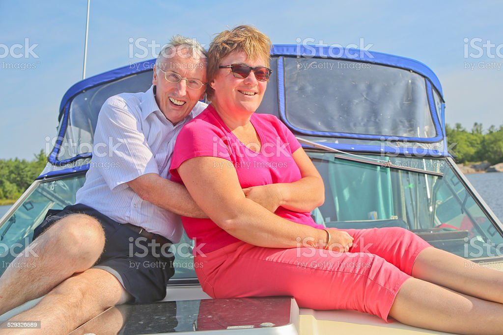 Two Mature Adults Hugging on a Yacht on Georgian Bay stock photo