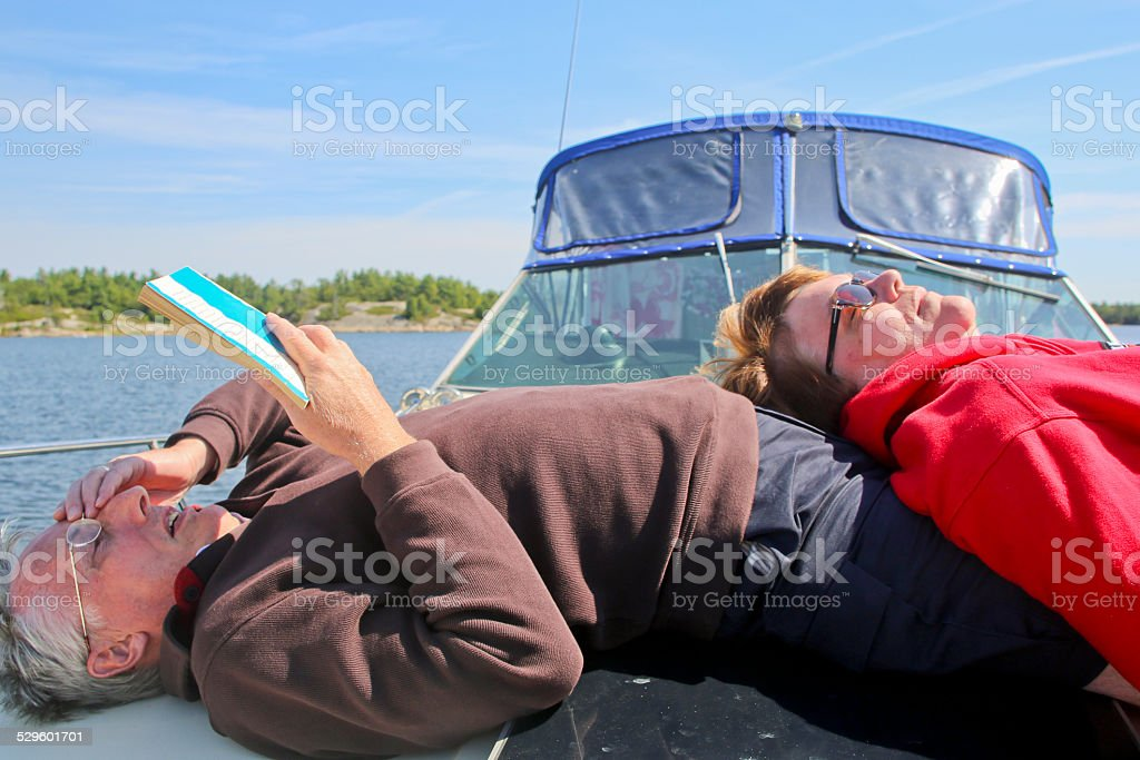 Two Mature Adults Relaxing on a Private Yacht stock photo