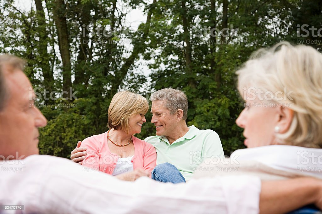 Two mature couples on a rowboat royalty-free stock photo