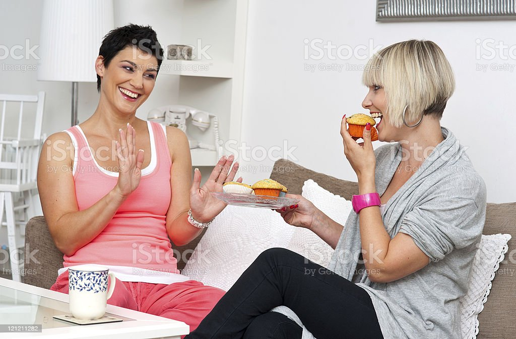 two mature woman friends chating over coffee royalty-free stock photo