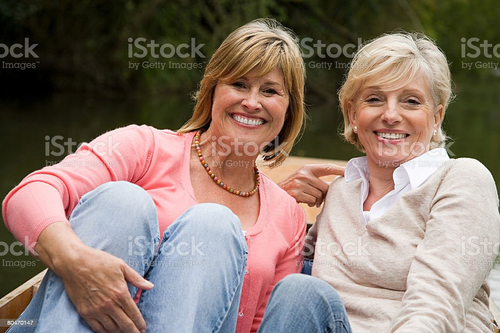 Two mature women in a rowboat royalty-free stock photo