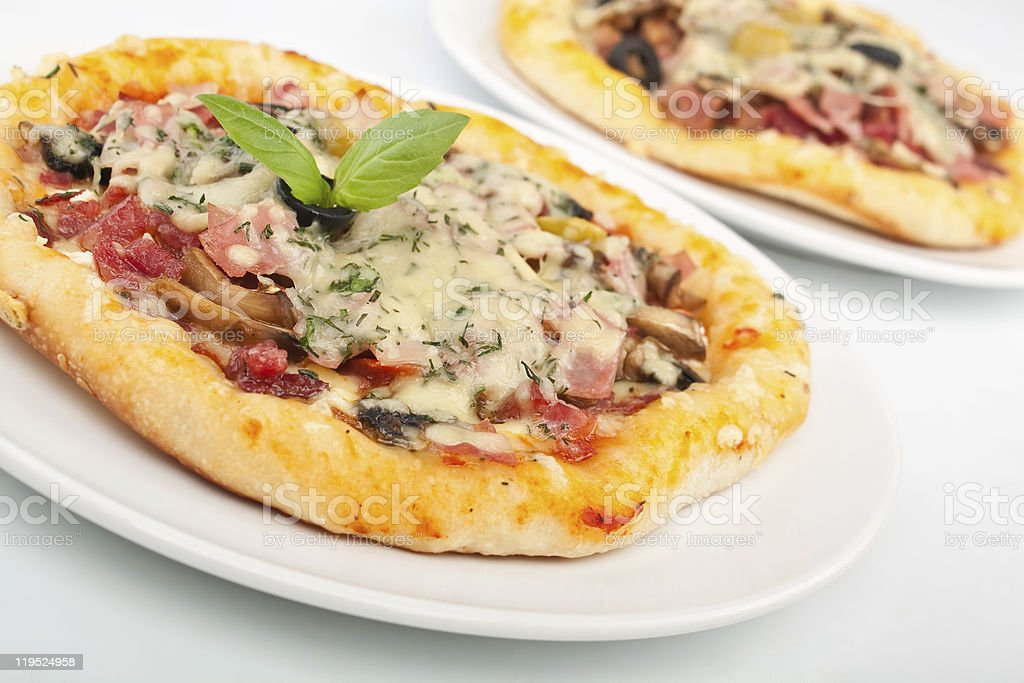two meat and mushroom pizzas royalty-free stock photo