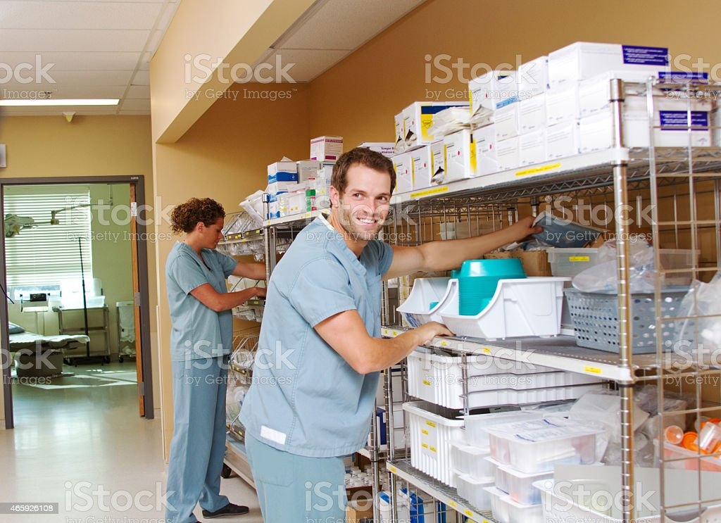 Two medical staff checking supplies stock photo