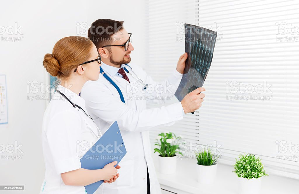 two medical worker doctor looking an x-ray stock photo