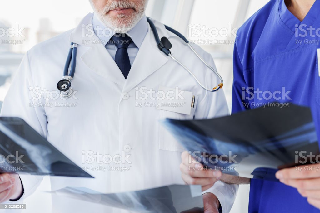 Two medical workers looking at radiograph stock photo