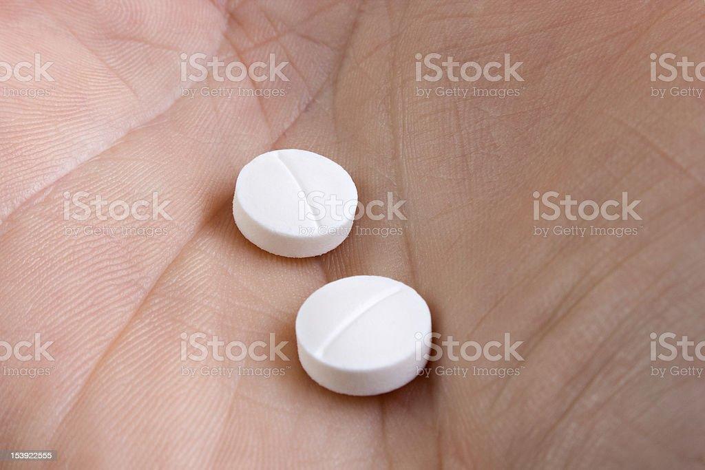 Two medicine pills, closeup royalty-free stock photo