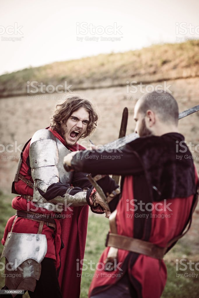 Two medieval Templar knights in the battle stock photo