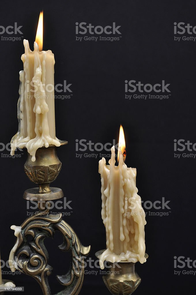 Two melting candles stock photo