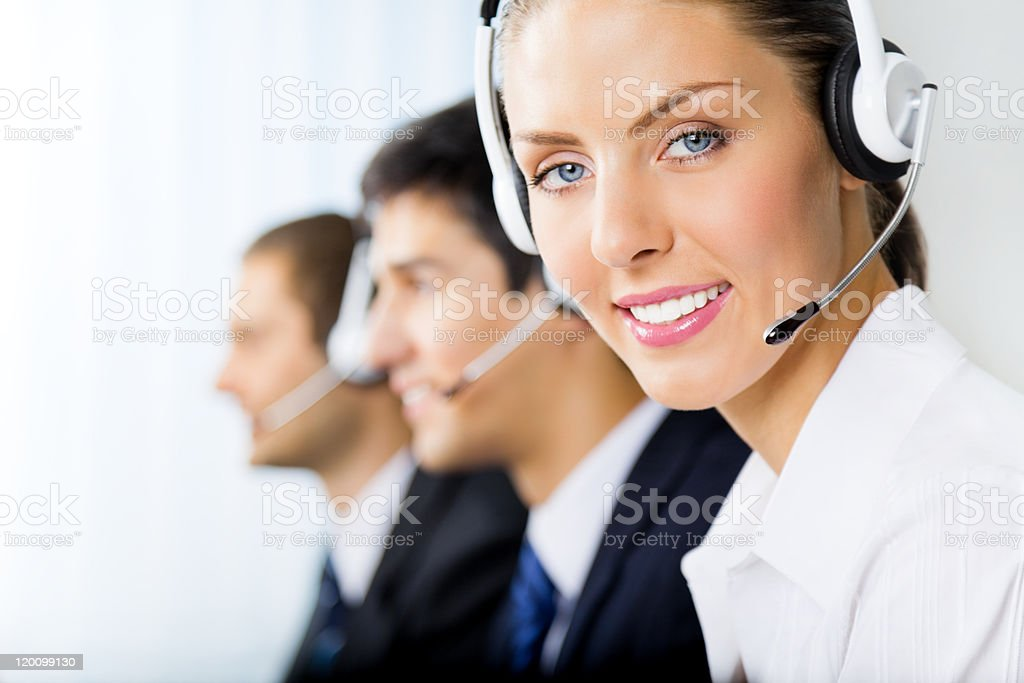 Two men and one woman phone support workers with headsets royalty-free stock photo