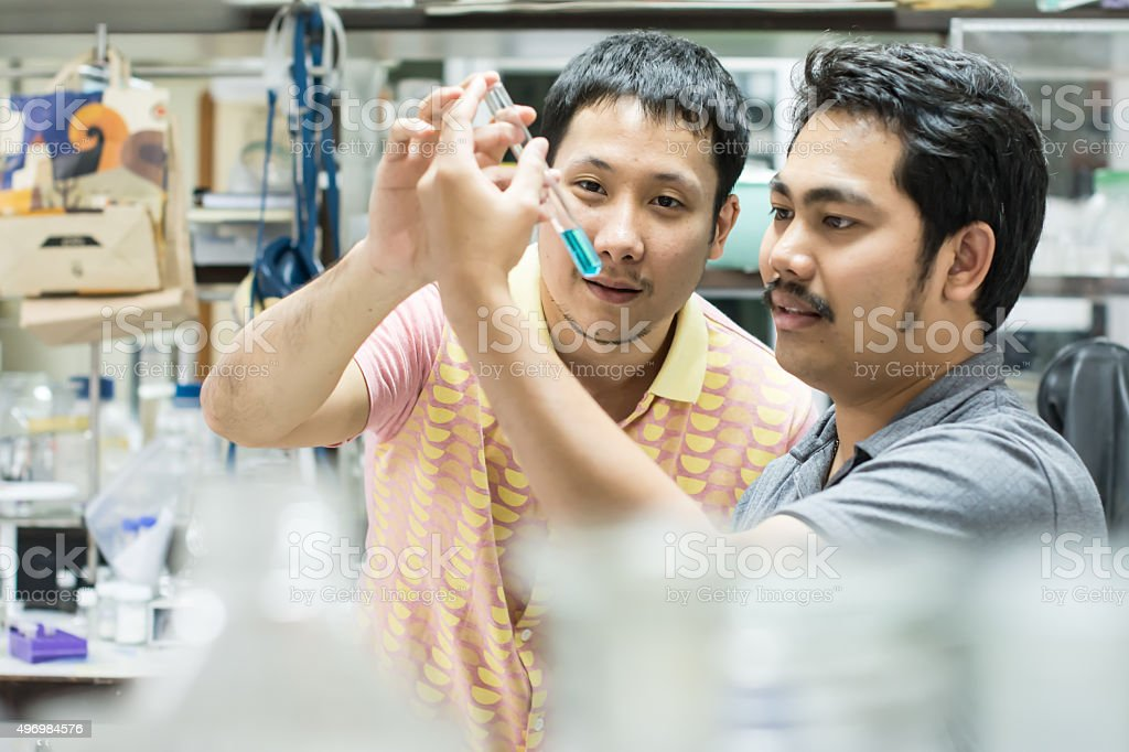 Two men are discussing about chemicals stock photo